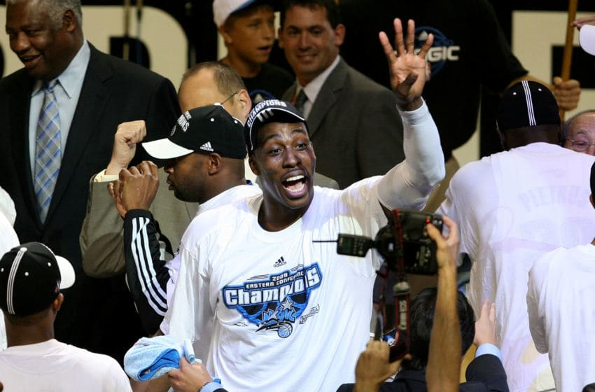 ORLANDO, FL - MAY 30: Dwight Howard #12 of the Orlando Magic celebrates on the court after defeating the Cleveland Cavaliers in Game Six of the Eastern Conference Finals during the 2009 Playoffs at Amway Arena on May 30, 2009 in Orlando, Florida. NOTE TO USER: User expressly acknowledges and agrees that, by downloading and or using this photograph, User is consenting to the terms and conditions of the Getty Images License Agreement (Photo by Doug Benc/Getty Images)