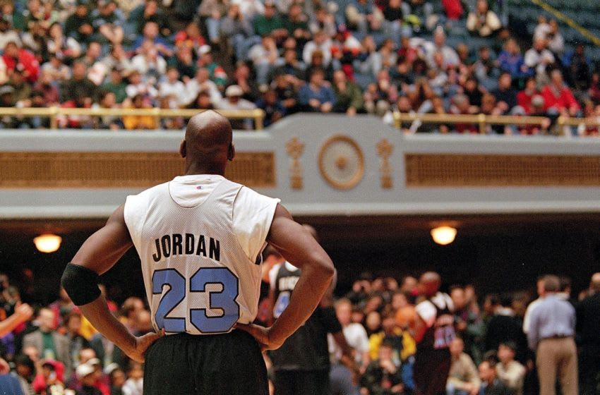 Michael Jordan looks on.