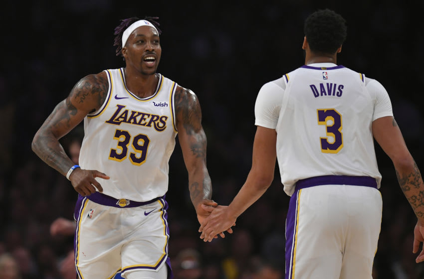 LOS ANGELES, CA - DECEMBER 29: Dwight Howard #39 and Anthony Davis #3 of the Los Angeles Lakers celebrate while playing the Dallas Mavericks at Staples Center on December 29, 2019 in Los Angeles, California. NOTE TO USER: User expressly acknowledges and agrees that, by downloading and/or using this photograph, user is consenting to the terms and conditions of the Getty Images License Agreement. (Photo by John McCoy/Getty Images)