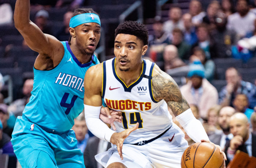 CHARLOTTE, NORTH CAROLINA - MARCH 05: Devonte' Graham #4 of the Charlotte Hornets defends Gary Harris #14 of the Denver Nuggets during the first quarter during their game at Spectrum Center on March 05, 2020 in Charlotte, North Carolina. NOTE TO USER: User expressly acknowledges and agrees that, by downloading and/or using this photograph, user is consenting to the terms and conditions of the Getty Images License Agreement. (Photo by Jacob Kupferman/Getty Images)