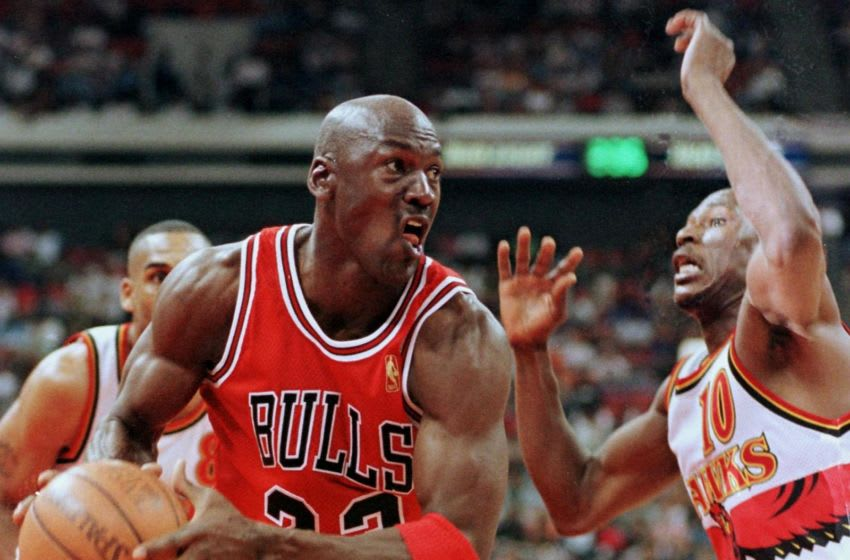Michael Jordan (L) of the Chicago Bulls tries to get around Mookie Blaylock 10 May during the second half of game three of their Eastern Conferecne Semifinals game at the Omni Coliseum in Atlanta Georgia. The Bulls won the game 100-80 to lead the series two game to one. AFP PHOTO Steve SCHAEFER (Photo by STEVE SCHAEFER / AFP) (Photo by STEVE SCHAEFER/AFP via Getty Images)