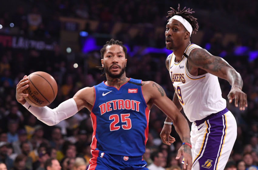 Jan 5, 2020; Los Angeles, California, USA; Detroit Pistons guard Derrick Rose (25) drives to the basket aganst Los Angeles Lakers center Dwight Howard (39) in the first half of the game at Staples Center. Mandatory Credit: Jayne Kamin-Oncea-USA TODAY Sports