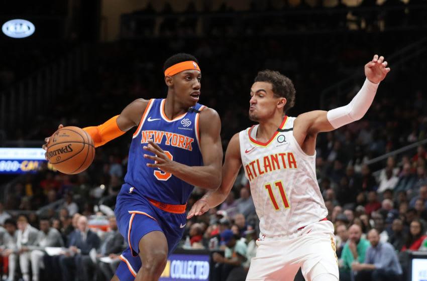 Mar 11, 2020; Atlanta, Georgia, USA; New York Knicks guard RJ Barrett (9) drives against Atlanta Hawks guard Trae Young (11) in the second quarter at State Farm Arena. Mandatory Credit: Jason Getz-USA TODAY Sports