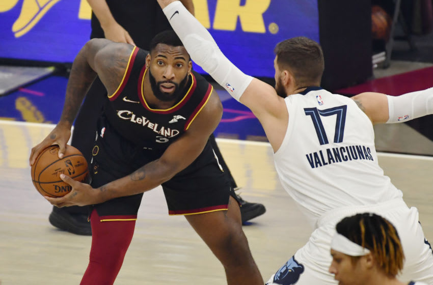 Jan 11, 2021; Cleveland, Ohio, USA; Memphis Grizzlies center Jonas Valanciunas (17) defends Cleveland Cavaliers center Andre Drummond (3) during the first quarter at Rocket Mortgage FieldHouse. Mandatory Credit: Ken Blaze-USA TODAY Sports