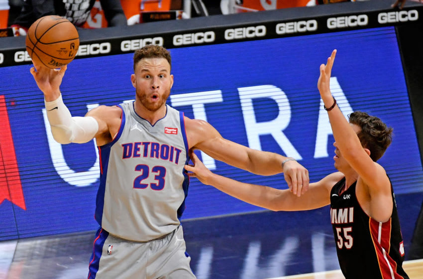 Jan 18, 2021; Miami, Florida, USA; Detroit Pistons forward Blake Griffin (23) passes the ball away from Miami Heat guard Duncan Robinson (55) during the second half at American Airlines Arena. Mandatory Credit: Jasen Vinlove-USA TODAY Sports