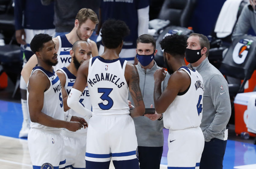 Feb 6, 2021; Oklahoma City, Oklahoma, USA; Minnesota Timberwolves head coach Ryan Saunders (middle, facing camera) talks to his team during a time out against the Oklahoma City Thunder in the second half at Chesapeake Energy Arena. Oklahoma City won 120-118. Mandatory Credit: Alonzo Adams-USA TODAY Sports