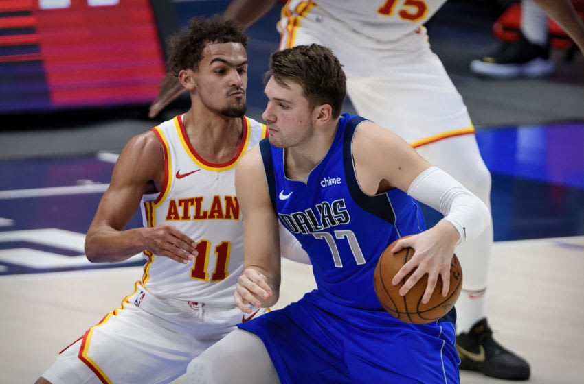 Feb 10, 2021; Dallas, Texas, USA; Atlanta Hawks guard Trae Young (11) defends against Dallas Mavericks guard Luka Doncic (77) during the second quarter at the American Airlines Center. Mandatory Credit: Jerome Miron-USA TODAY Sports
