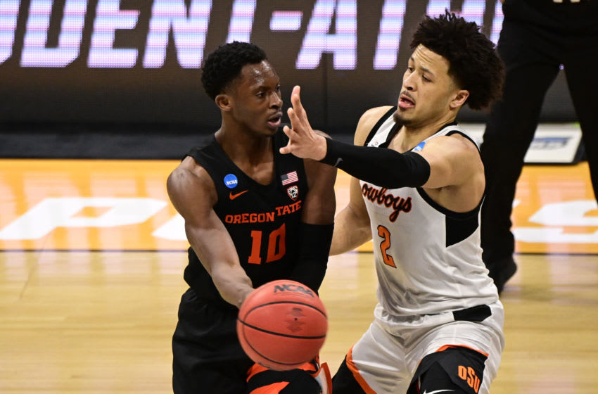 Mar 21, 2021; Indianapolis, Indiana, USA; Oregon State Beavers forward Warith Alatishe (10) passes the ball while pressured by Oklahoma State Cowboys guard Cade Cunningham (2) during the second half in the second round of the 2021 NCAA Tournament at Hinkle Fieldhouse. Mandatory Credit: Marc Lebryk-USA TODAY Sports