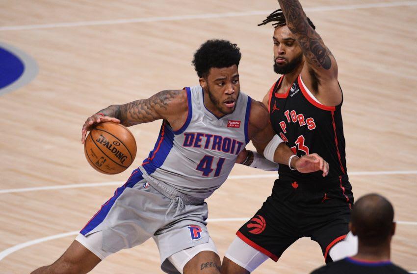 Mar 29, 2021; Detroit, Michigan, USA; Detroit Pistons forward Saddiq Bey (41) drives to the basket as Toronto Raptors guard Gary Trent Jr. (33) defends during the first quarter at Little Caesars Arena. Mandatory Credit: Tim Fuller-USA TODAY Sports