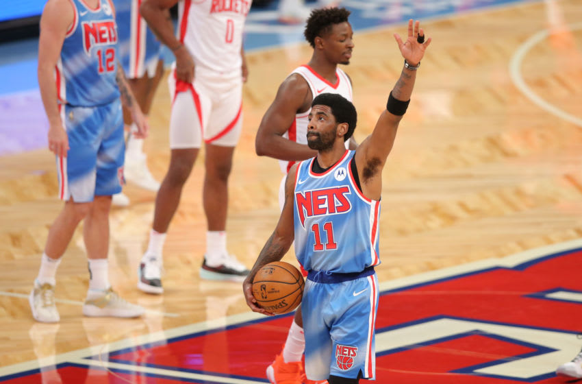 Mar 31, 2021; Brooklyn, New York, USA; Brooklyn Nets point guard Kyrie Irving (11) acknowledges the crowd before tip-off against the Houston Rockets at Barclays Center. Mandatory Credit: Brad Penner-USA TODAY Sports
