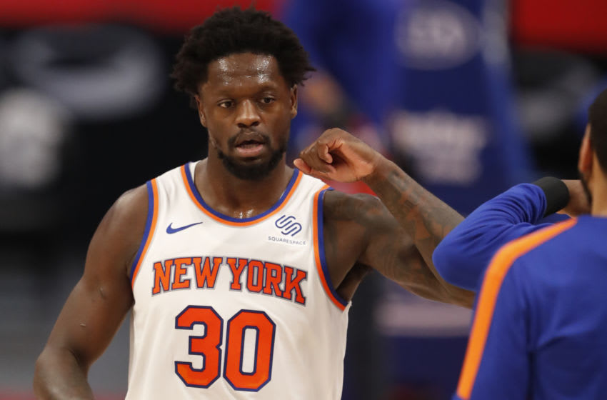 Apr 3, 2021; Detroit, Michigan, USA; New York Knicks forward Julius Randle (30) celebrates with teammates during the first quarter against the Detroit Pistons at Little Caesars Arena. Mandatory Credit: Raj Mehta-USA TODAY Sports