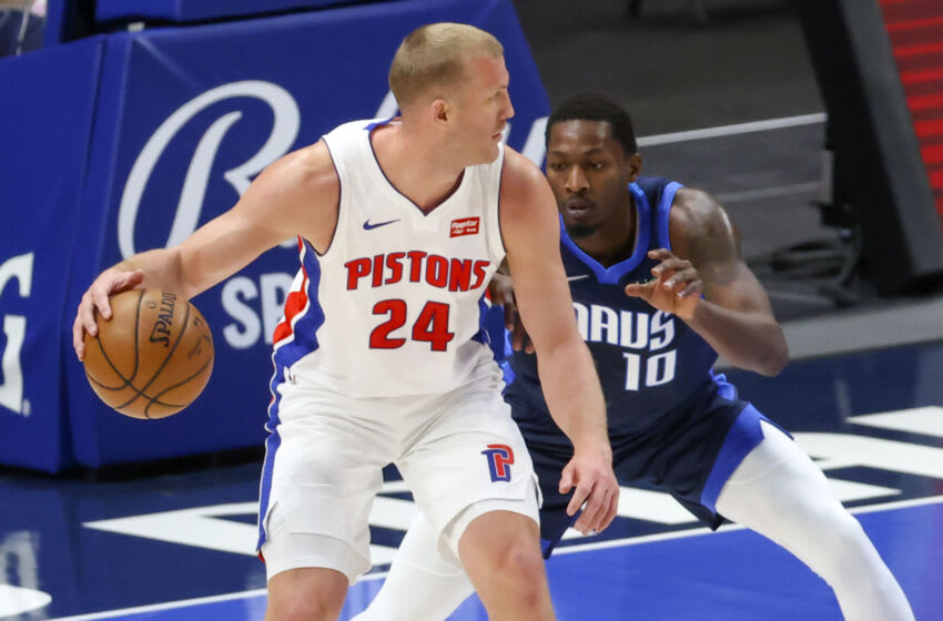 Apr 21, 2021; Dallas, Texas, USA; Detroit Pistons center Mason Plumlee (24) looks to score as Dallas Mavericks forward Dorian Finney-Smith (10) defends during the first quarter at American Airlines Center. Mandatory Credit: Kevin Jairaj-USA TODAY Sports