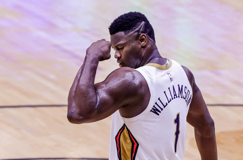 May 3, 2021; New Orleans, Louisiana, USA; New Orleans Pelicans forward Zion Williamson (1) flexes his muscle after making a basket against Golden State Warriors forward Draymond Green (23) during the second half at the Smoothie King Center. Mandatory Credit: Stephen Lew-USA TODAY Sports