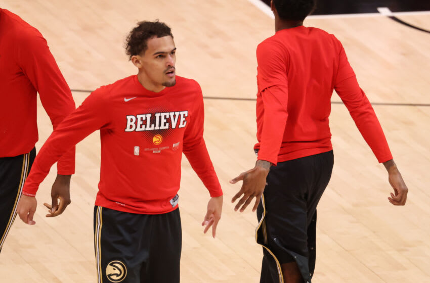 Jul 3, 2021; Atlanta, Georgia, USA; Atlanta Hawks guard Trae Young greets teammates before their game against Milwaukee Bucks of game six of the Eastern Conference Finals for the 2021 NBA Playoffs at State Farm Arena. Mandatory Credit: Jason Getz-USA TODAY Sports