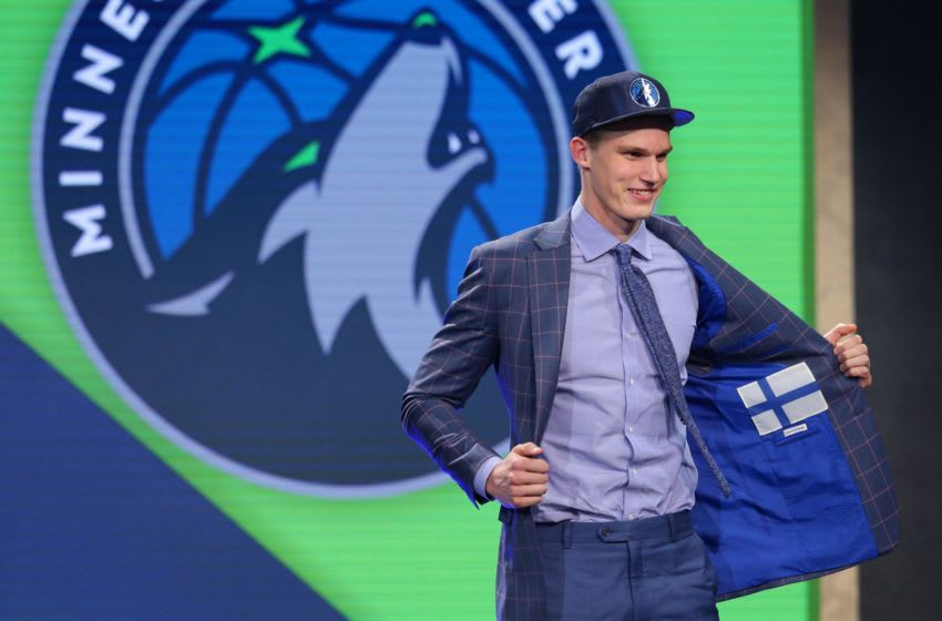 Jun 22, 2017; Brooklyn, NY, USA; Lauri Markkanen (Arizona) shows off the inside of his suit jacket as he is introduced as the number seven overall pick to the Minnesota Timberwolves in the first round of the 2017 NBA Draft at Barclays Center. Mandatory Credit: Brad Penner-USA TODAY Sports