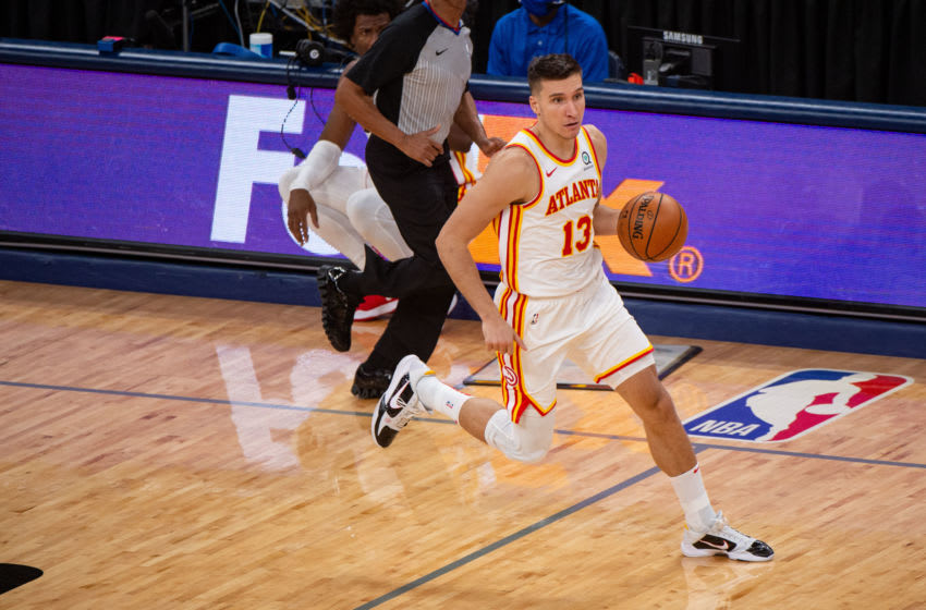 Dec 26, 2020; Memphis, Tennessee, USA; Atlanta Hawks guard Bogdan Bogdanovic (13) brings the ball up court during the game against the Memphis Grizzlies at FedExForum. Mandatory Credit: Justin Ford-USA TODAY Sports