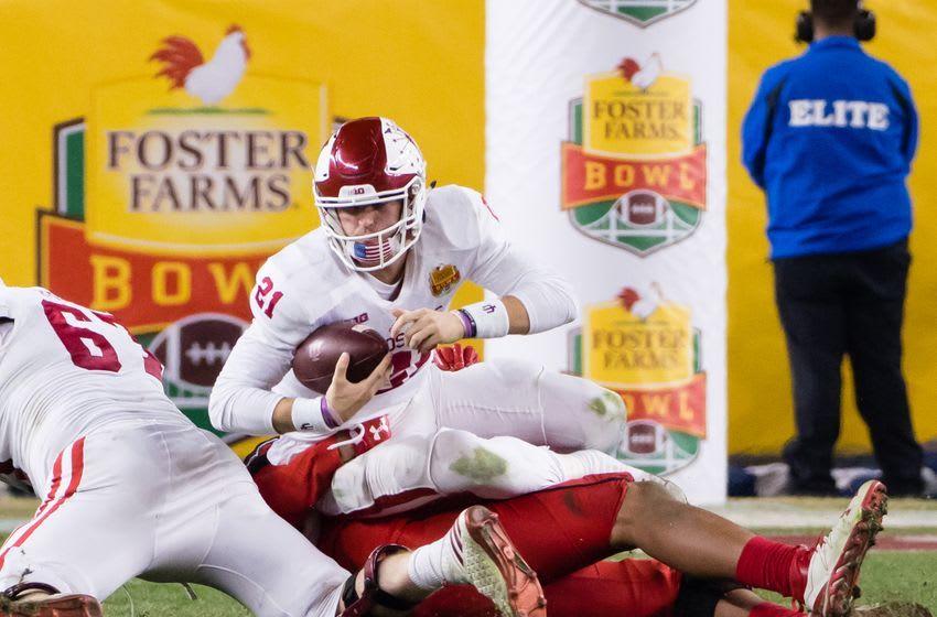 Dec 28, 2016; Santa Clara, CA, USA; Indiana Hoosiers quarterback Richard Lagow (21) is sacked by Utah Utes defensive tackle Filipo Mokofisi (45) during the fourth quarter at Levi