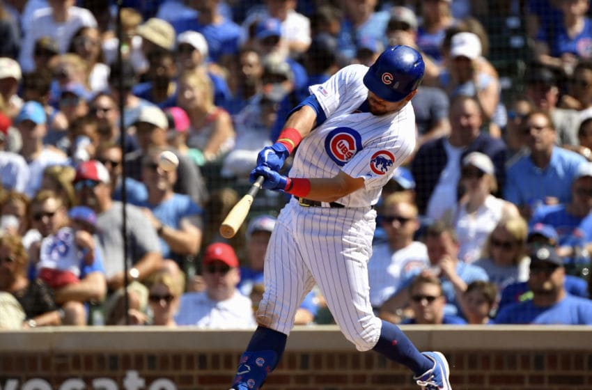 CHICAGO, ILLINOIS - AUGUST 04: Kyle Schwarber #12 of the Chicago Cubs hits a home run in the fifth inning against the Milwaukee Brewers at Wrigley Field on August 04, 2019 in Chicago, Illinois. (Photo by Quinn Harris/Getty Images)