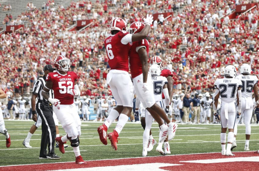 BLOOMINGTON, INDIANA - SEPTEMBER 21: Whop Philyor #1 and Donavan Hale #6 of the Indiana Hoosiers celebrate after a touchdown during the first quarter in the game against the Connecticut Huskies at Memorial Stadium on September 21, 2019 in Bloomington, Indiana. (Photo by Justin Casterline/Getty Images)