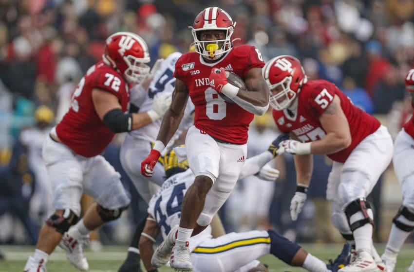BLOOMINGTON, IN - NOVEMBER 23: Stevie Scott III #8 of the Indiana Hoosiers runs the ball during the first half against the Michigan Wolverines at Memorial Stadium on November 23, 2019 in Bloomington, Indiana. (Photo by Michael Hickey/Getty Images)