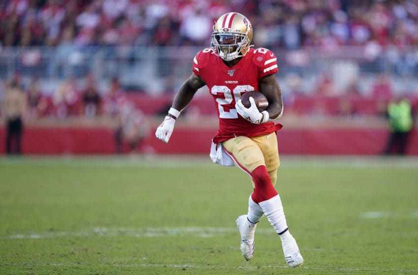 SANTA CLARA, CALIFORNIA - NOVEMBER 17: Running back Tevin Coleman #26 of the San Francisco 49ers rushes the football against the Arizona Cardinals during the second half of the NFL game at Levi's Stadium on November 17, 2019 in Santa Clara, California. (Photo by Thearon W. Henderson/Getty Images)