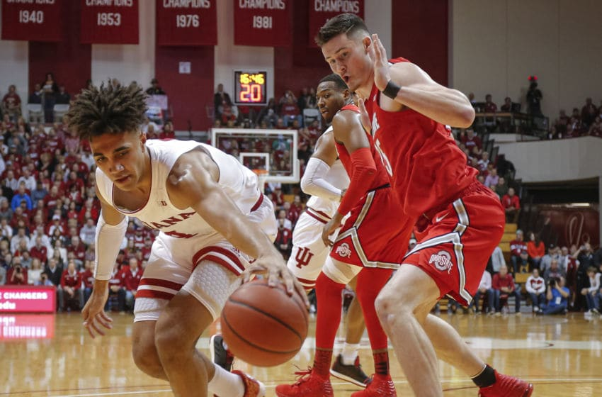 BLOOMINGTON, IN - JANUARY 11: Trayce Jackson-Davis #4 of the Indiana Hoosiers reaches for the loose ball as Kyle Young #25 of the Ohio State Buckeyes defends during the first half at Assembly Hall on January 11, 2020 in Bloomington, Indiana. (Photo by Michael Hickey/Getty Images)