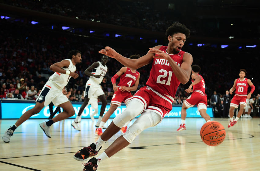 NEW YORK, NEW YORK - DECEMBER 10: Jerome Hunter #21 of the Indiana Hoosiers slips on the court during the first half of their game against the Connecticut Huskies at Madison Square Garden on December 10, 2019 in New York City. (Photo by Emilee Chinn/Getty Images)