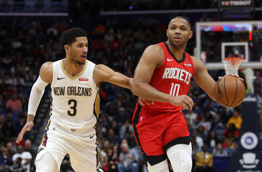 NEW ORLEANS, LOUISIANA - DECEMBER 29: Eric Gordon #10 of the Houston Rockets drives the ball around Josh Hart #3 of the New Orleans Pelicans at Smoothie King Center on December 29, 2019 in New Orleans, Louisiana. NOTE TO USER: User expressly acknowledges and agrees that, by downloading and/or using this photograph, user is consenting to the terms and conditions of the Getty Images License Agreement. (Photo by Chris Graythen/Getty Images)