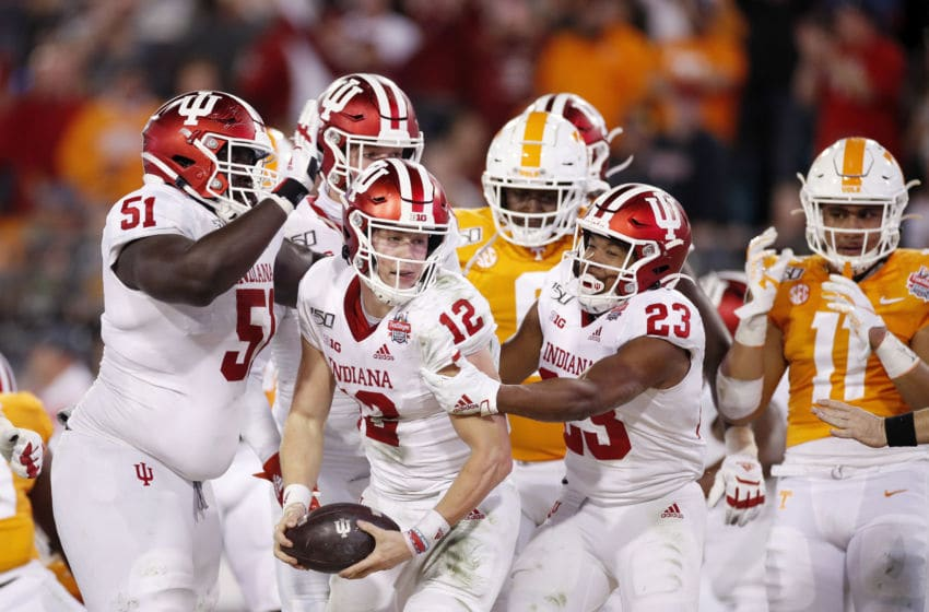 JACKSONVILLE, FL - JANUARY 02: Peyton Ramsey #12 of the Indiana Hoosiers is congratulated by teammates after scoring a one-yard touchdown in the second half of the TaxSlayer Gator Bowl against the Tennessee Volunteers at TIAA Bank Field on January 2, 2020 in Jacksonville, Florida. (Photo by Joe Robbins/Getty Images)