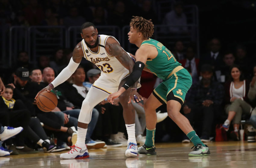 LOS ANGELES, CALIFORNIA - FEBRUARY 23: LeBron James #23 of the Los Angeles Lakers handles the ball against Romeo Langford #45 of the Boston Celtics during the third quarter at Staples Center on February 23, 2020 in Los Angeles, California. (Photo by Katelyn Mulcahy/Getty Images)