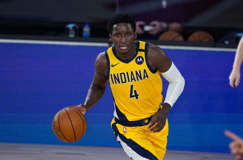 LAKE BUENA VISTA, FLORIDA - AUGUST 4: Victor Oladipo #4 of the Indiana Pacers controls the ball against the Orlando Magic during the first half of an NBA basketball game on August 4, 2020 in Lake Buena Vista, Florida. NOTE TO USER: User expressly acknowledges and agrees that, by downloading and or using this photograph, User is consenting to the terms and conditions of the Getty Images License Agreement. (Photo by Ashley Landis - Pool/Getty Images)