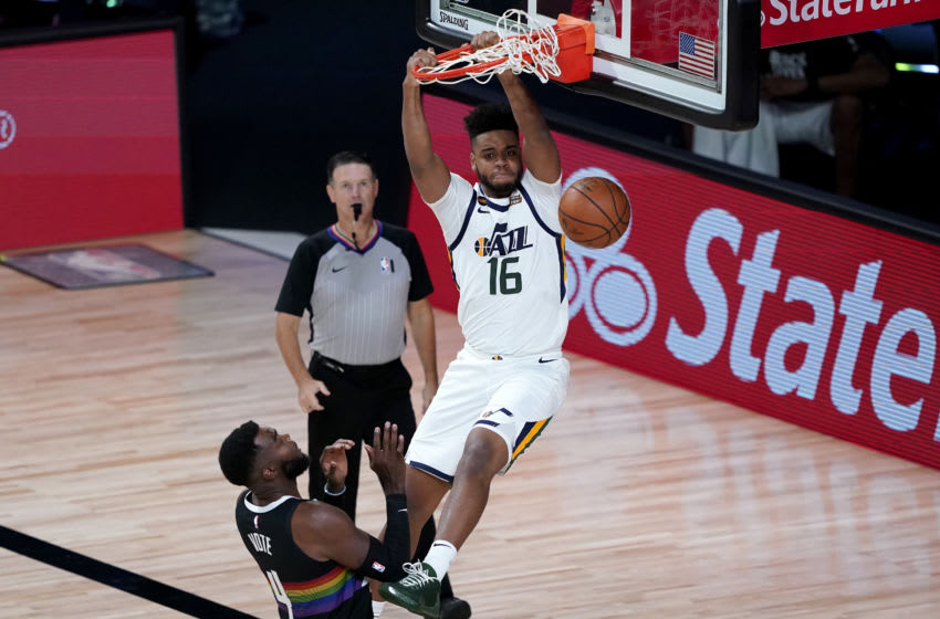 LAKE BUENA VISTA, FLORIDA - AUGUST 19: Juwan Morgan #16 of the Utah Jazz dunks over Paul Millsap #4 of the Denver Nuggets during the second half of Game Two of a first round playoff game at AdventHealth Arena at ESPN Wide World Of Sports Complex on August 19, 2020 in Lake Buena Vista, Florida. NOTE TO USER: User expressly acknowledges and agrees that, by downloading and or using this photograph, User is consenting to the terms and conditions of the Getty Images License Agreement. (Photo by Ashley Landis-Pool/Getty Images)