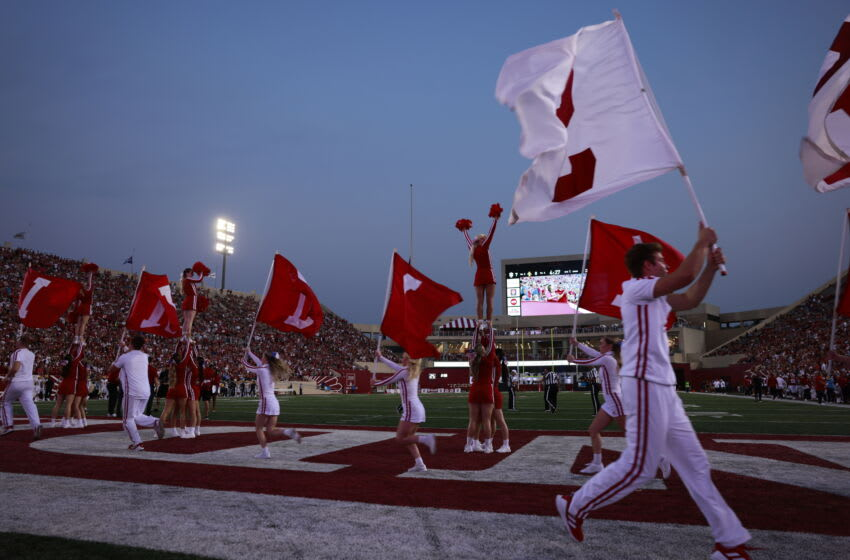 Indiana University cheerleaders carry flags (Photo by Jeremy Hogan/SOPA Images/LightRocket via Getty Images)