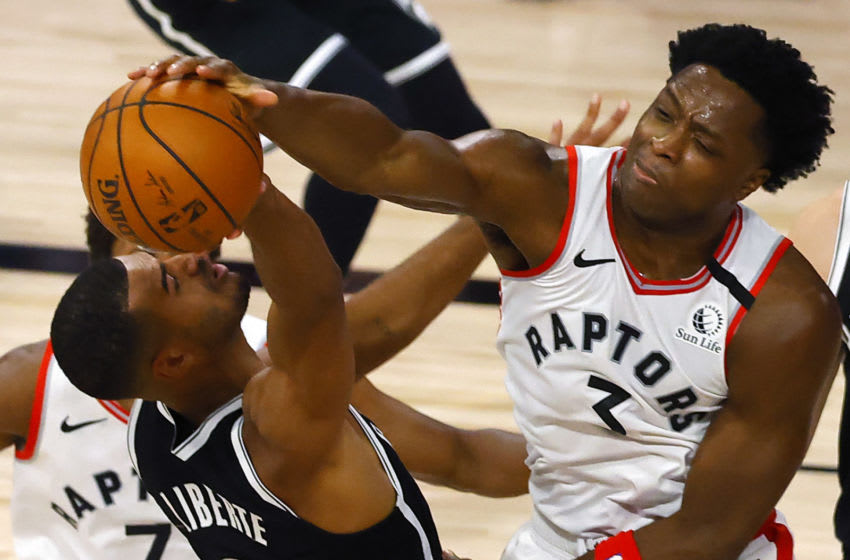 LAKE BUENA VISTA, FLORIDA - AUGUST 19: OG Anunoby #3 of the Toronto Raptors blocks a shot attempt by Timothe Luwawu-Cabarrot #9 of the Brooklyn Nets during the first quarter in Game Two of the Eastern Conference First Round during the 2020 NBA Playoffs at The Field House at ESPN Wide World Of Sports Complex on August 19, 2020 in Lake Buena Vista, Florida. NOTE TO USER: User expressly acknowledges and agrees that, by downloading and or using this photograph, User is consenting to the terms and conditions of the Getty Images License Agreement. (Photo by Kevin C. Cox/Getty Images)