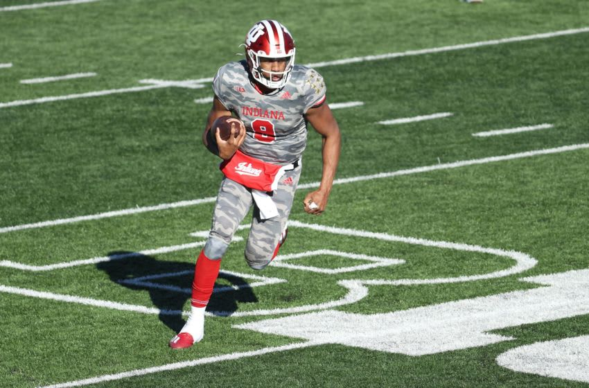 BLOOMINGTON, INDIANA - NOVEMBER 28: Michael Penix Jr #9 of the Indiana Hoosiers runs with the ball against the Maryland Terrapins during the game at Memorial Stadium on November 28, 2020 in Bloomington, Indiana. (Photo by Andy Lyons/Getty Images)