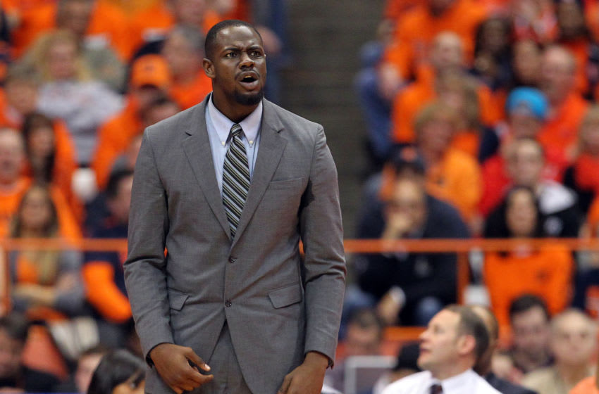 SYRACUSE, NY - FEBRUARY 23: Assistant coach Kenya Hunter of the Georgetown Hoyas reacts after a play during the game against the Syracuse Orange at the Carrier Dome on February 23, 2013 in Syracuse, New York. (Photo by Nate Shron/Getty Images)