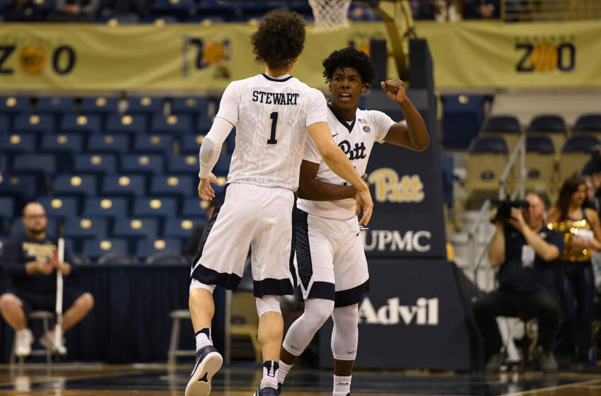 PITTSBURGH, PA - FEBRUARY 13: Parker Stewart #1 of the Pittsburgh Panthers reacts with Marcus Carr #5 after a three point basket in the first half during the game against the Boston College Eagles at Petersen Events Center on February 13, 2018 in Pittsburgh, Pennsylvania. (Photo by Justin Berl/Getty Images)