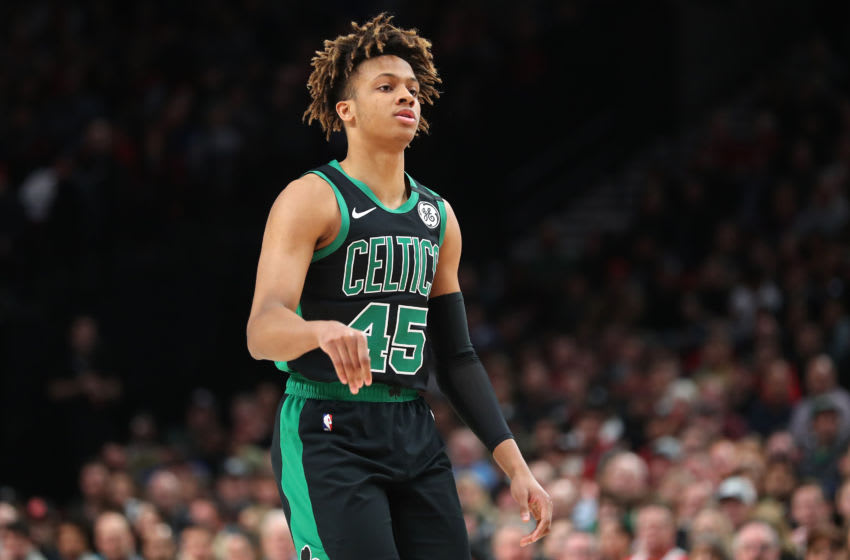 PORTLAND, OREGON - FEBRUARY 25: Romeo Langford #45 of the Boston Celtics looks on against the Portland Trail Blazers in the first quarter during their game at Moda Center on February 25, 2020 in Portland, Oregon. NOTE TO USER: User expressly acknowledges and agrees that, by downloading and or using this photograph, User is consenting to the terms and conditions of the Getty Images License Agreement. (Photo by Abbie Parr/Getty Images)