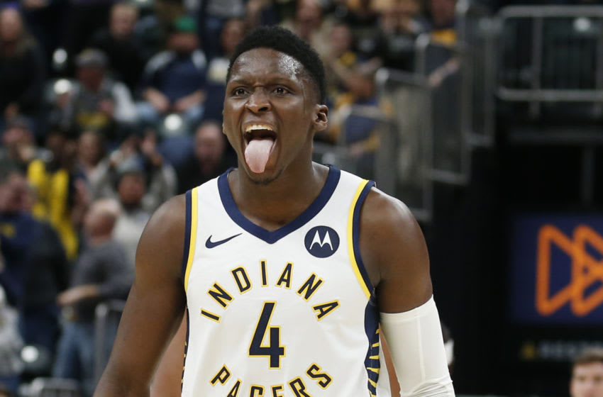 Mar 10, 2020; Indianapolis, Indiana, USA; Indiana Pacers guard Victor Oladipo (4) reacts after making a three point basket against the Boston Celtics during the fourth quarter at Bankers Life Fieldhouse. Mandatory Credit: Brian Spurlock-USA TODAY Sports