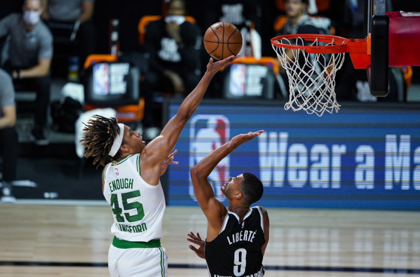 Aug 5, 2020; Lake Buena Vista, Florida, USA; Boston Celtics guard Romeo Langford (45) shoots over Brooklyn Nets guard Timothe Luwawu-Cabarrot (9) during the first half of an NBA basketball game Wednesday, Aug. 5, 2020 in Lake Buena Vista, Fla. at The Arena. Mandatory Credit: Ashley Landis/Pool Photo-USA TODAY Sports