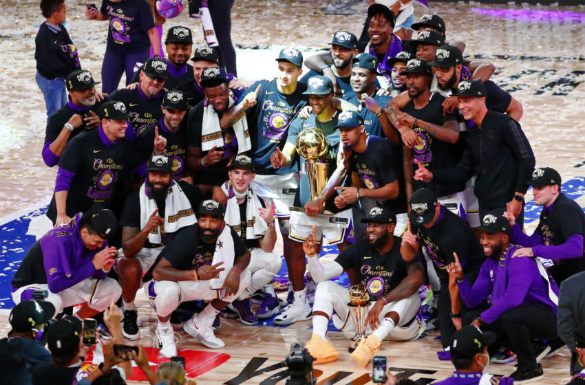 Oct 11, 2020; Lake Buena Vista, Florida, USA; The Los Angeles Lakers pose for a photo after game six of the 2020 NBA Finals at AdventHealth Arena. The Los Angeles Lakers won 106-93 to win the series. Mandatory Credit: Kim Klement-USA TODAY Sports