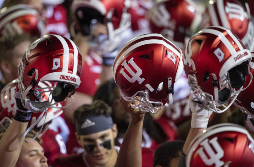 Oct 24, 2020; Bloomington, Indiana, USA; Indiana Hoosiers raise their helmets after the game at Memorial Stadium. The Indiana Hoosiers defeated the Penn State Nittany Lions 36 to 35. Mandatory Credit: Marc Lebryk-USA TODAY Sports