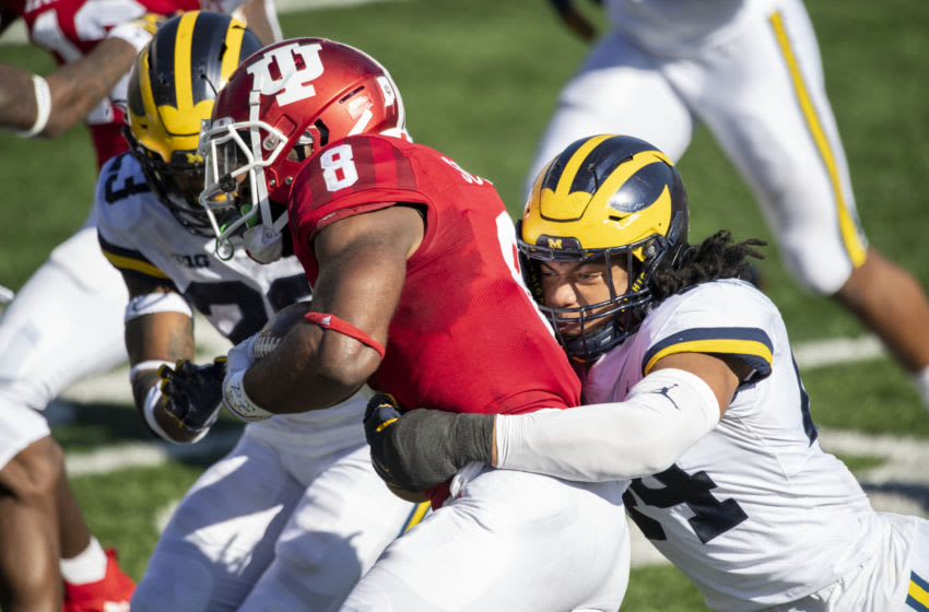 Nov 7, 2020; Bloomington, Indiana, USA; Michigan Wolverines linebacker Cameron McGrone (44) tackles Indiana Hoosiers running back Stevie Scott III (8) during the first quarter of the game against the Michigan Wolverines at Memorial Stadium. Mandatory Credit: Marc Lebryk-USA TODAY Sports