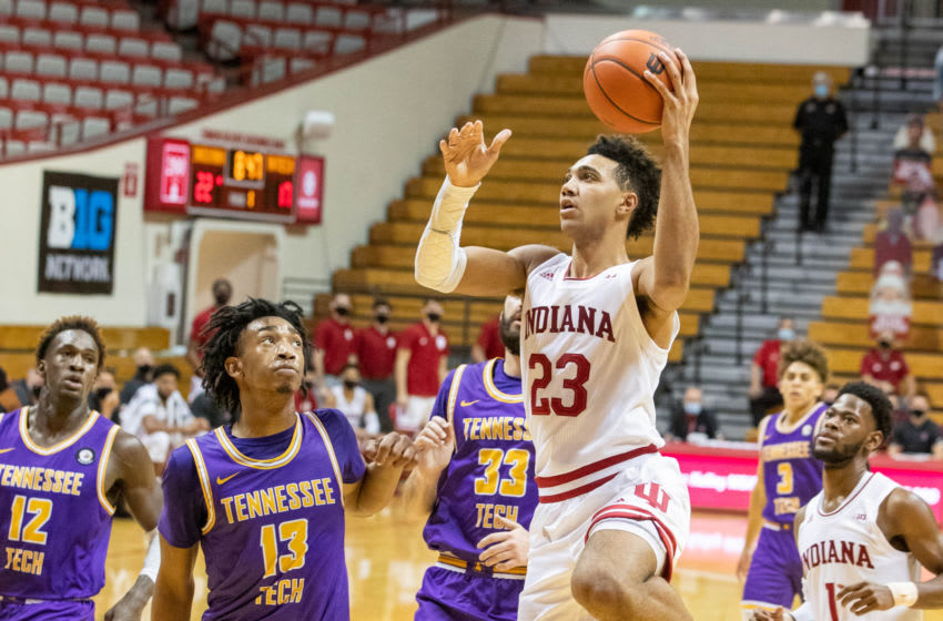 Nov 25, 2020; Bloomington, Indiana, USA; Indiana Hoosiers forward Trayce Jackson-Davis (23) shoots the ball against Tennessee Tech Golden Eagles forward Kenny White Jr. (13) in the first half at Simon Skjodt Assembly Hall. Mandatory Credit: Trevor Ruszkowski-USA TODAY Sports