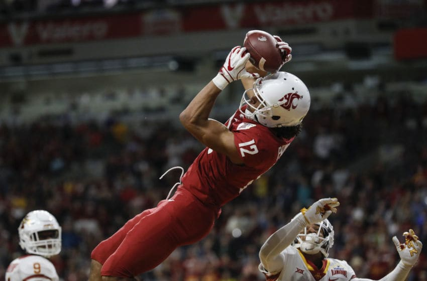 SAN ANTONIO, TX - DECEMBER 28: Dezmon Patmon #12 of the Washington State Cougars catches a pass for a touchdown in the second quarter defended by D'Andre Payne #1 of the Iowa State Cyclones during the Valero Alamo Bowl at the Alamodome on December 28, 2018 in San Antonio, Texas. (Photo by Tim Warner/Getty Images)