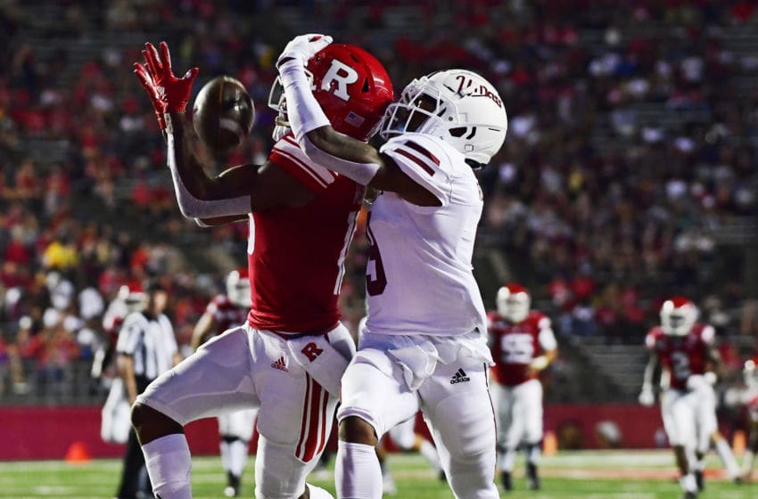 PISCATAWAY, NJ - AUGUST 30: Bo Melton #18 of the Rutgers Scarlet Knights hauls in a touchdown pass against Isaiah Rodgers #9 of the Massachusetts Minutemen during the second quarter at SHI Stadium on August 30, 2019 in Piscataway, New Jersey. (Photo by Corey Perrine/Getty Images)