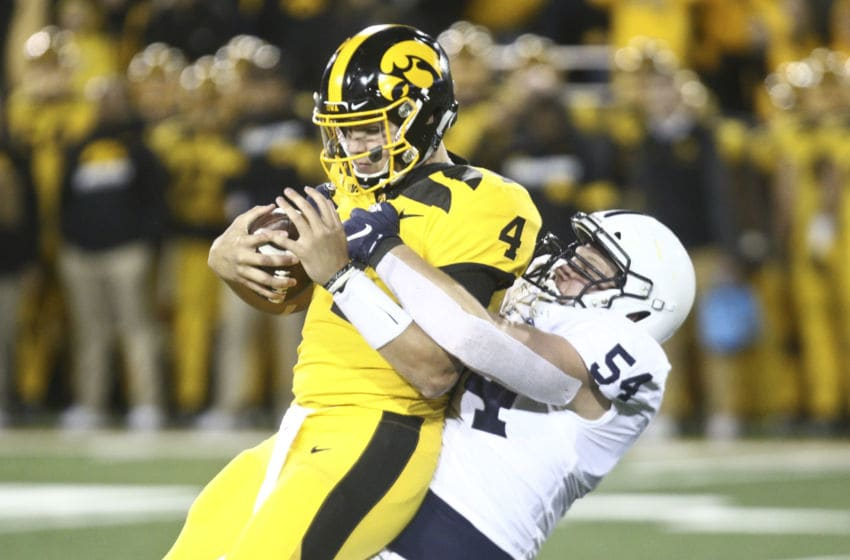 IOWA CITY, IOWA- OCTOBER 12: Quarterback Nate Stanley #4 of the Iowa Hawkeyes is sacked during the second half by defensive tackler Robert Windsor #54 of the Penn State Nittany Lions on October 12, 2019 at Kinnick Stadium in Iowa City, Iowa. (Photo by Matthew Holst/Getty Images)