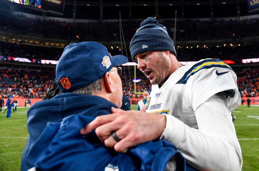 DENVER, CO - DECEMBER 1: Philip Rivers #17 of the Los Angeles Chargers meets with head coach Vic Fangio of the Denver Broncos on the field after the Denver Broncos 23-20 win over the Los Angeles Chargers at Empower Field at Mile High on December 1, 2019 in Denver, Colorado. (Photo by Dustin Bradford/Getty Images)