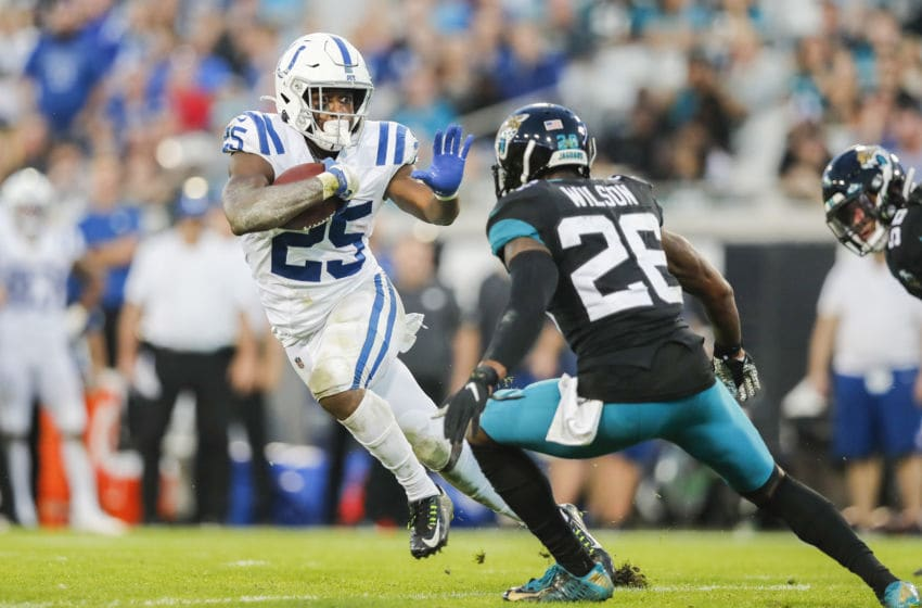 Marlon Mack #25 of the Indianapolis Colts runs for yardage during the second quarter of a game against the Jacksonville Jaguars at TIAA Bank Field on December 29, 2019 in Jacksonville, Florida. (Photo by James Gilbert/Getty Images)
