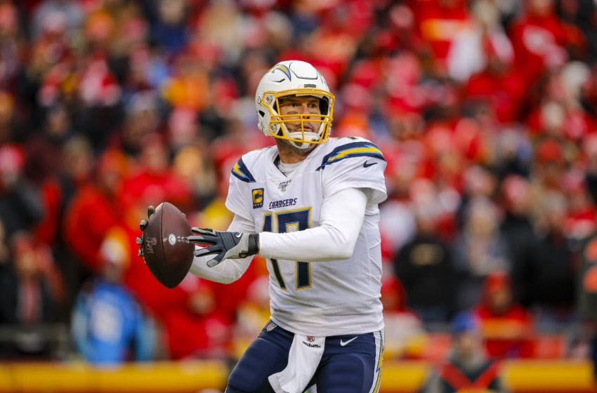 KANSAS CITY, MO - DECEMBER 29: Philip Rivers #17 of the Los Angeles Chargers looks for an open receiver during the third quarter against the Kansas City Chiefs at Arrowhead Stadium on December 29, 2019 in Kansas City, Missouri. (Photo by David Eulitt/Getty Images)